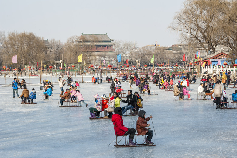 Beijing,China-February 15,2013: People have a fun with the sledge at skating rink in ShiChahai