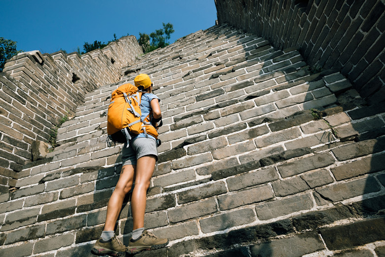woman tourist looking up on the way to climbing of great wall
