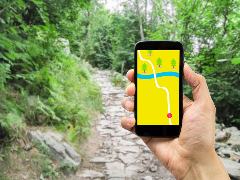 hiker using smartphone gps on travel hike living healthy active