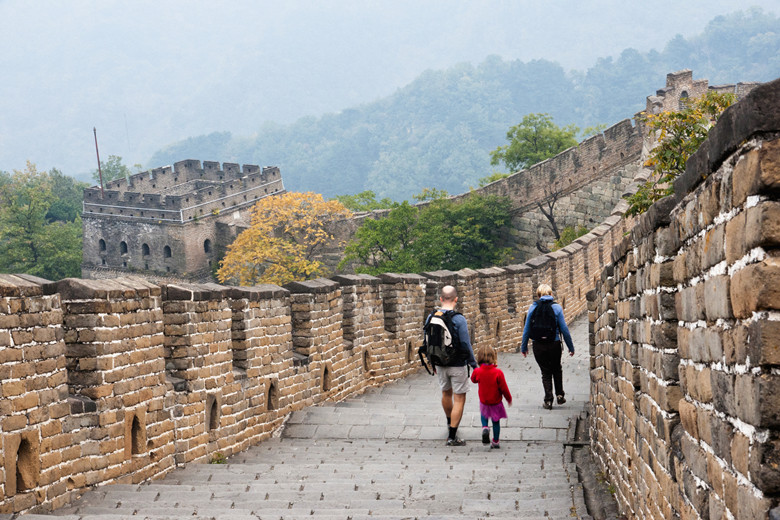 Couple with child walking on Great Wall of China at Mutianyu, China, Asia