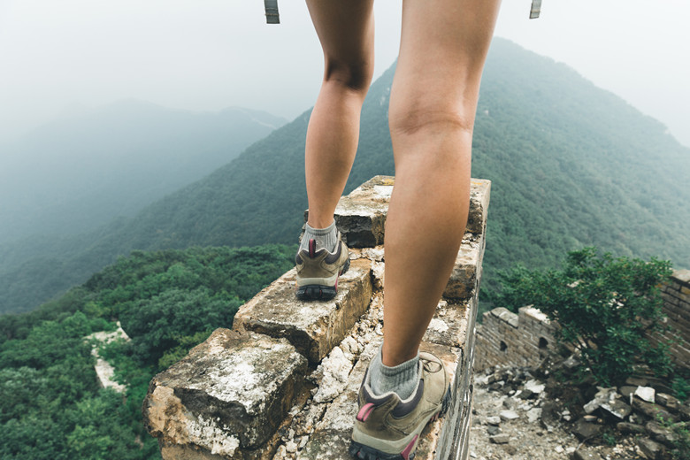 successful woman hiker enjoy the view on the top of great wall
