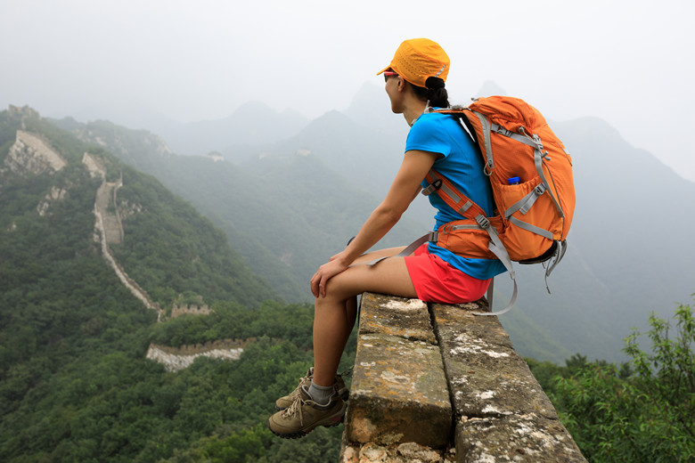young woman hiker enjoy the view on great wall